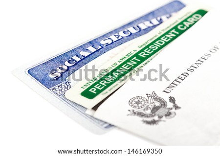 United States of America social security and green card on white background. Immigration concept. Closeup with shallow depth of field. - stock photo