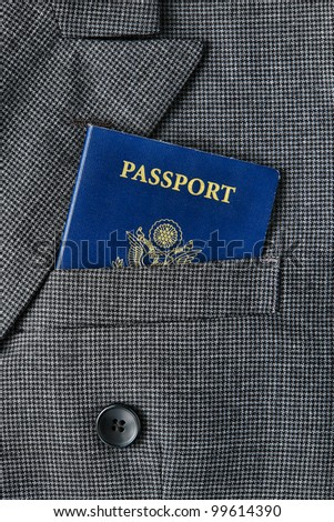 United States of America US citizenship passport book in an American executive business man suit jacket breast pocket for a corporate trip abroad - stock photo