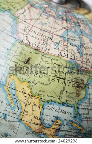 United States on an old worn and dirty toy globe - stock photo