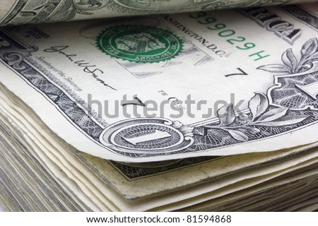 United States one dollar bill laying in a stack of money. - stock photo