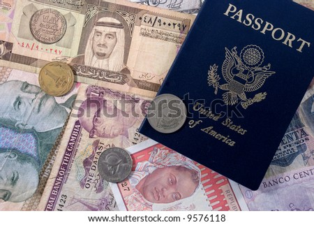 United States Passport and currency from various countries - stock photo