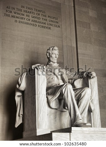 United States president Abraham Lincoln National Memorial landmark marble sculpture and commemorative historic text engraved in monument wall in the USA federal capital of Washington DC - stock photo