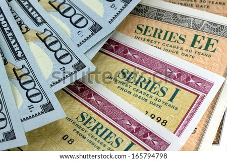 United States Savings Bonds with American Currency - Financial Security - stock photo