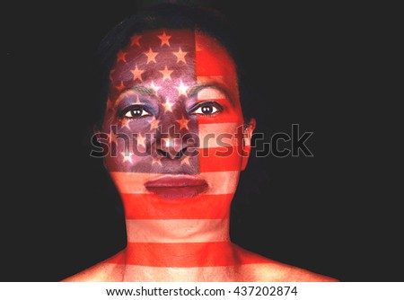 United States stars and stripes flag superimposed over the face of African American woman - stock photo