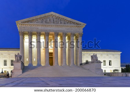 United States Supreme Court Building at night in Washington, DC  - stock photo