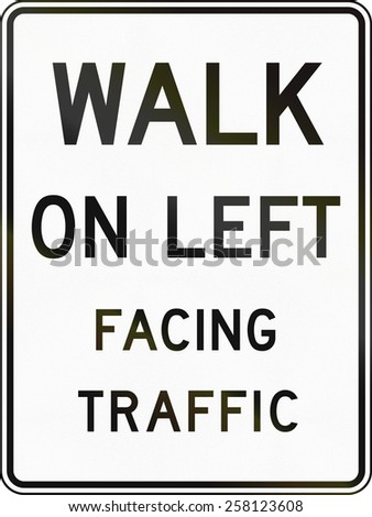 United States traffic sign: Walk On Left Facing Traffic - stock photo