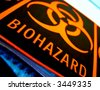 Universal biohazard danger warning label on laboratory equipment in a science research lab - stock photo