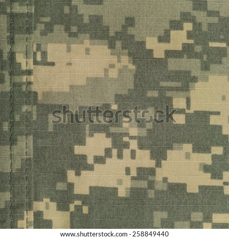 Universal camouflage pattern army combat uniform digital camo double thread seam USA military ACU macro closeup rip-stop fabric texture background, green, desert tan, urban NYCO, nylon cotton vertical - stock photo