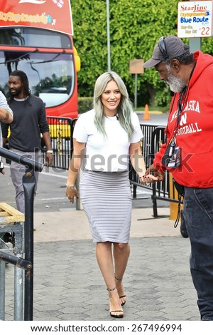 UNIVERSAL CITY CA - APRIL 7, 2015: Actress/singer Hilary Duff is on the set of the entertainment news program 'Extra' at Universal Studios Hollywood April 7, 2015 Universal City CA. - stock photo