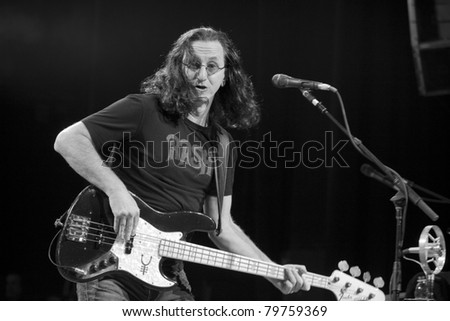UNIVERSAL CITY, CA - JUNE 22: Geddy Lee of the rock band Rush hits the stage for part of their Time Machine Tour at the Gibson Amphitheater in Universal City, CA on June 22, 2011. - stock photo