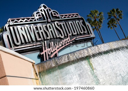 "UNIVERSAL CITY, CA - JUNE 4, 2014: The Universal Studios Hollywood sign greeting visitors outside the amusement park. It's official marketing headline is ""The Entertainment Capital of LA""."