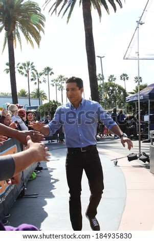 UNIVERSAL CITY CA - MARCH 31, 2014: Matt Leinert talks to Mario Lopez for Extra at Universal Studios Hollywood March 31, 2014 Universal City CA. - stock photo