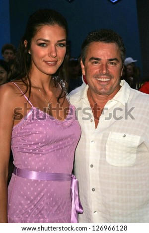 """UNIVERSAL CITY - JULY 19: Adrianne Curry and Christopher Knight at the Premiere Screening of """"Light Years Away"""" at Universal City Walk Cinemas July 19, 2006 in Universal City, CA - stock photo"""