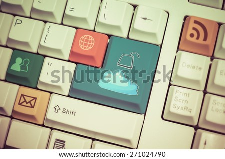 Universal internet symbol keyboard with cloud unlock button on enter in vintage color - stock photo
