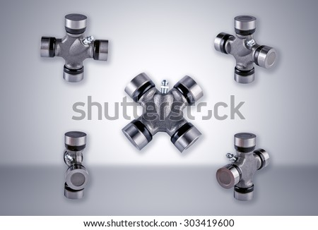 Universal joint carved on a white background and in different positions - stock photo