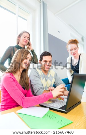 University college students using laptop for project team work learning