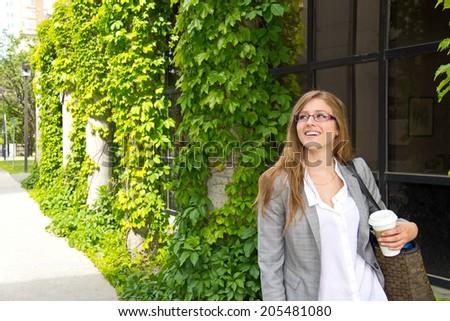 University grad student on campus - stock photo