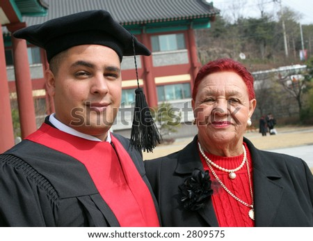 University graduate with his grandmother - happy and successful