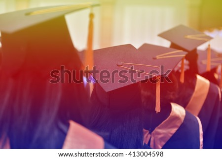 University graduates Express their joy by throwing hat. - stock photo