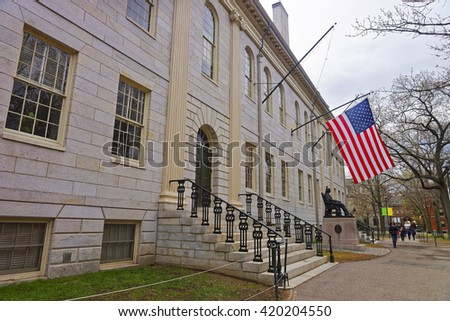 University Hall and John Harvard Monument in the campus of Harvard University of Cambridge, Massachusetts, MA, USA. It is a well-known statue of the University founder in America. Tourists in the yard - stock photo
