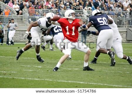 UNIVERSITY PARK, PA - APRIL 24: Penn State quarterback Matthew McGloin drops back to pass at Beaver Stadium April 24, 2010 in University Park, PA - stock photo