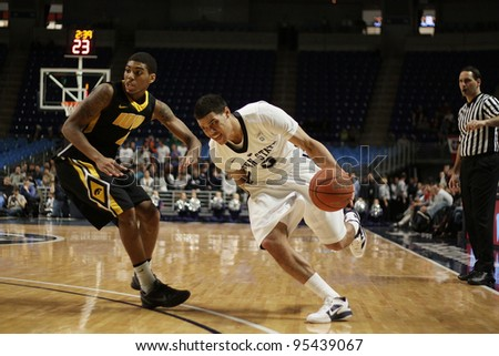 UNIVERSITY PARK, PA - FEB 16: Penn State's Matt Glover drives strong to the basket against Iowa at the Byrce Jordan Center February 16, 2012 in University Park, PA - stock photo
