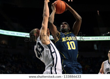 UNIVERSITY PARK, PA - FEBRUARY 27: Michigan's Tim Hardaway Jr. drives to the basket against Penn State at the Byrce Jordan Center February 27, 2013 in University Park, PA