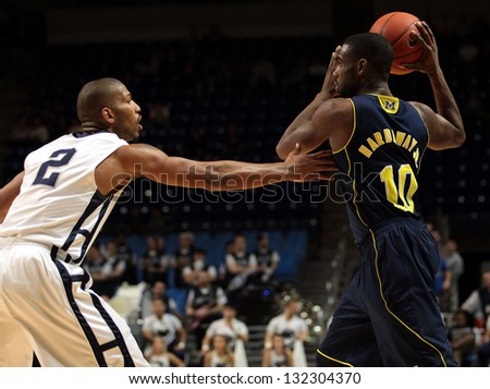 UNIVERSITY PARK, PA -  FEBRUARY 27: Michigan's Tim Hardaway Jr. looks to pass against Penn State  at the Byrce Jordan Center February 27, 2013 in University Park, PA - stock photo