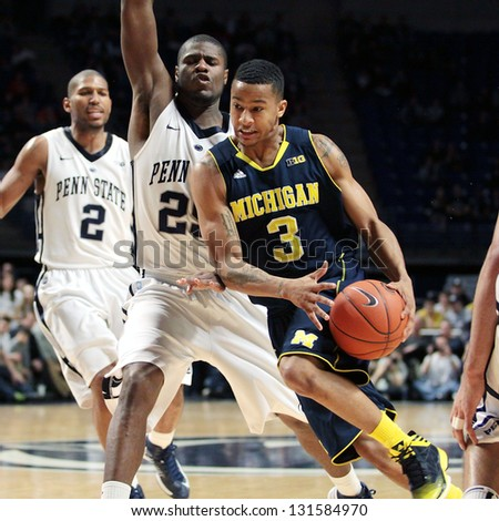UNIVERSITY PARK, PA - FEBRUARY 27: Michigan's Trey Burke No. 3 drives to the basket against Penn State at the Byrce Jordan Center February 27, 2013 in University Park, PA - stock photo