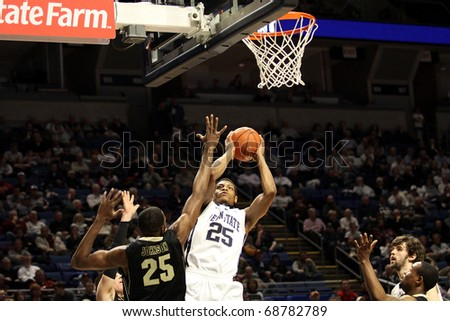 UNIVERSITY PARK, PA - JANUARY 5: Penn State's Jeff Brooks shoots over Purdue's JaJuan Johnson at the Byrce Jordan Center January 5, 2011 in University Park, PA