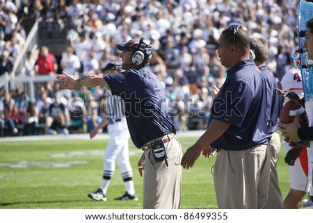 UNIVERSITY PARK, PA - OCT 9: Illinois defensive coaches call out the signals during a game against Penn State at Beaver Stadium on October 9, 2010 in University Park, PA - stock photo