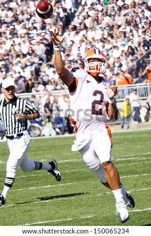 UNIVERSITY PARK, PA - OCT 9: Illinois quarterback No. 2, Nathan Scheelhaase throws an off-balance pass during a game against Penn State at Beaver Stadium on October 9, 2010 in University Park, PA  - stock photo