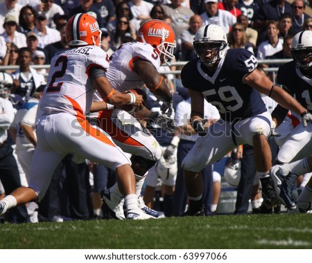 UNIVERSITY PARK, PA - OCT 9: Penn State's No. 59 Pete Massaro tries to get around the block against Illinois at Beaver Stadium October 9, 2010 in University Park, PA