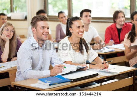 University student in classroom listening a lecturer - stock photo
