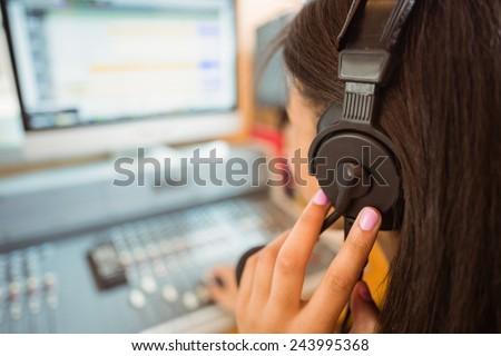 University student mixing audio in a studio of a radio - stock photo