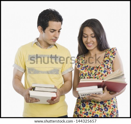 University students looking at a book