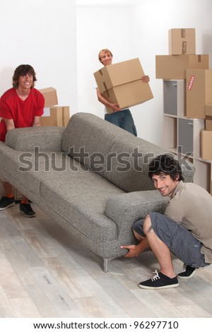 University students moving in together - stock photo