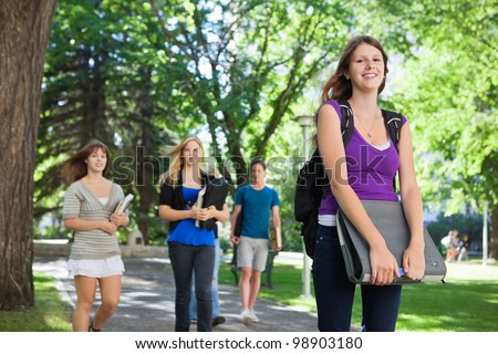 University students on their way to class - stock photo