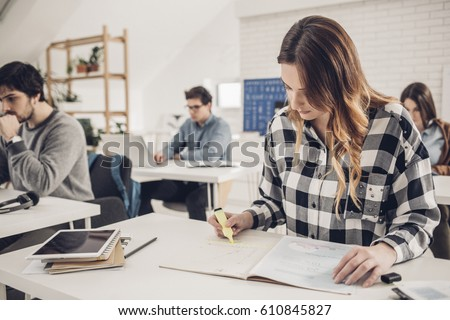 University students studying in classroom.