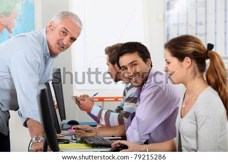 University students working at computers - stock photo