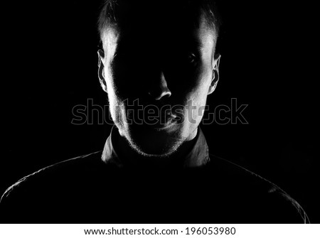 Unknown  male person silhouette.Back lit studio isolated - stock photo