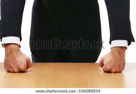 Unknown man standing near desk, isolated on white background