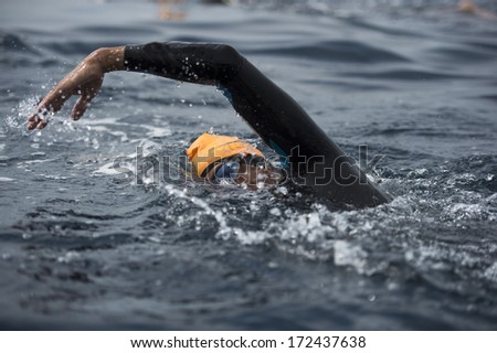 Unknown Swimmer at sea. - stock photo