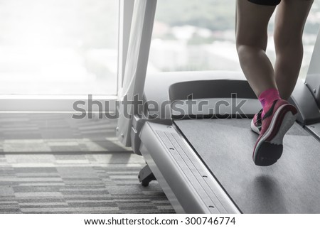 Unknown woman wear pink running shoes workout by thread mill in fitness  fitness.woman  - stock photo