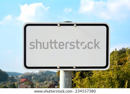 unlabeled white sign at the roadside