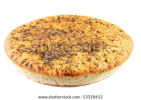 Unleavened wheat cake with spices . Isolated over white background .