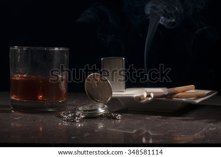 Unlit Cigars and Scotch on the Rocks with Cigars in Foreground