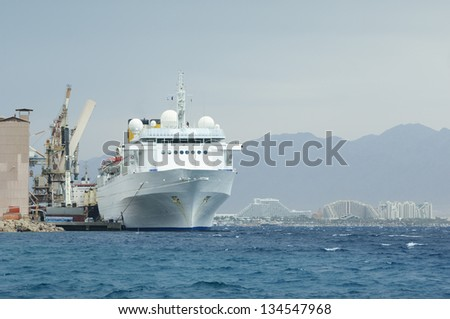 Unloading ship in Eilat harbor - stock photo
