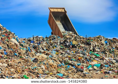 unloading truck in a mountain of trash - stock photo