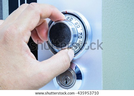 Unlock safe box by hand rotate - stock photo